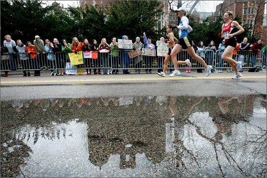 2007 Even during rainy years, the crowd still cheers on runners.