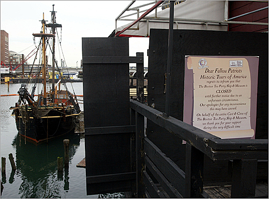 For nearly a decade, the city of Boston has been without a Tea Party museum, a piece of history that defines the Boston Harbor and its place in the American Revolution. After many setbacks, construction is finally set to begin on a new, more comprehensive and interactive museum on the Fort Point Channel that will include all new replica ships and a tour that brings visitors back to 1773. It is set to be completed in spring 2012. The museum property has seen a lot since a fire destroyed the gift shop in 2001. Look through the slides to see the history of the museum and what is planned for its future. Pictured: the closed museum shop in 2002.