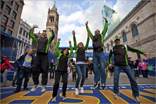 Many runners spent Sunday touring the finish area of the Boston Marathon and posed for photos. Todd Shaw, Mykalene Shaw, Chaleh Trujillo, Chris Trujillo, and Clay Wilkes (from left), all of Utah, attempted to have their photo taken by a friend while jumping in the air.