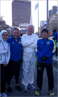 From left: Joesphine Rucquoi, Burt Palmer, Richard Cannon, and Greg Knoffl became fast friends while waiting in the cold at Boston Common. Temperatures were hovering just over 40 at 7 a.m.