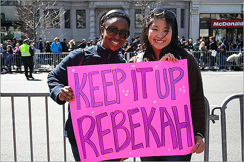 Danielle Burckson of Jamaica Plain and Jess Liu of Somerville made this sign for their friend Rebekah Mueller, who was running her first marathon for Bottom Line, Inc. Liu said that Mueller decided to run the marathon to get in shape for her Memorial Day weekend wedding.