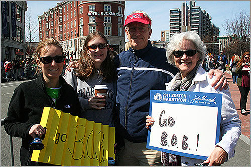 April Frazer of Charlotte, N.C., Rob Frazer, of Charleston, S.C., Beth Frazer, of Greenville, S.C., and Betsy Frazer, of Charleston, S.C., decorated cowbells and made signs for April's husband (Betsy and Rob's son and Beth's brother) Bob, who was running his first Boston Marathon and third marathon overall. 'He was definitely nervous last night, but running this marathon was his ultimate dream as a kid,' April said. Bob's post-marathon meal request? A Sam Adams and a lobster at the Chart House.