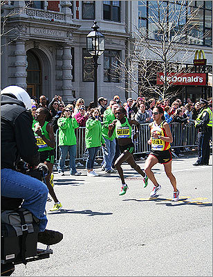 The front of the women's pack sped through Kenmore Square: Caroline Kilel of Kenya, Sharon Cherup of Kenya, and Desiree Davila of the United States.