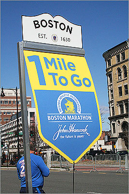 A welcome sight for weary runners: the 1-mile to go sign in Kenmore Square.