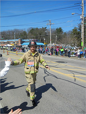 James Gefke from Glendale, WI, ran in full firefighting gear.