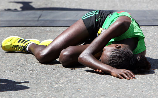 Caroline Kilel, of Kenya, collapsed to the ground after winning the women's elite race. She had to be helped up afterward.