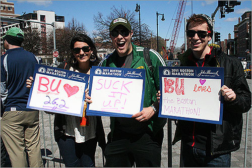 Boston University freshmen Shanti Kapoor, Harrison Smith, and Jeremy Lowe made signs to encourage two running friends.