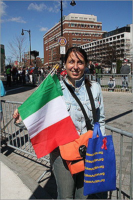 Fabiano Vurchio waved Italian flags as she waited for her fiance, Simone Vanmori, to pass through Kenmore Square. The couple arrived from Milan on Saturday.
