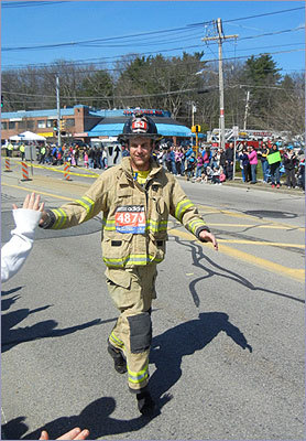 James Gefke of Glendale, Wis., ran in full firefighting gear.