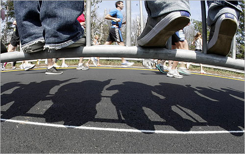 Wellesley College students cast shadows as they stood on metal barriers.