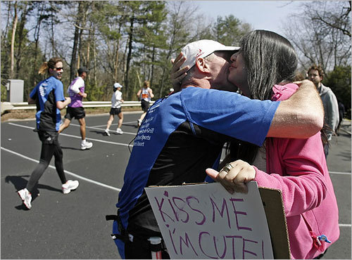 Wellesley College sophomore Jiezhen Wu, of Singapore, got a kiss from a passing runner outside the college.