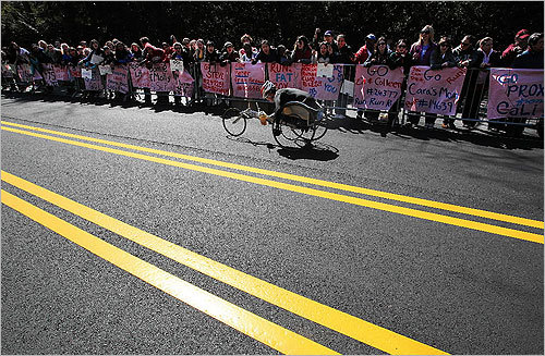 Supporters cheered on marathoners during the wheelchair race.