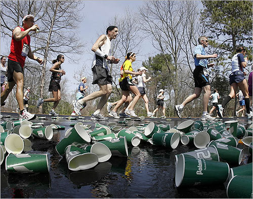 Runners made their way through discarded cups from a water station.