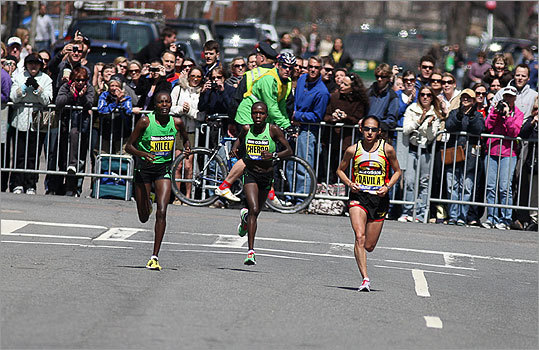 Caroline Kilel (left) Sharon Cherop (center) and Desiree Davila race down Boylston Street toward the finish. Kilel won the battle, followed by Davila and Cherop.