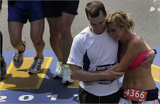 Two runners celebrated their engagement after crossing the finish line.