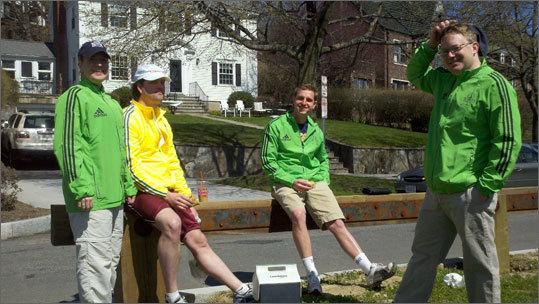 Volunteers for BostonFit Jaime Kidston, Sam Kidston, William Kidston, and Patrick Herron staff the Heartbreak Hill water station.