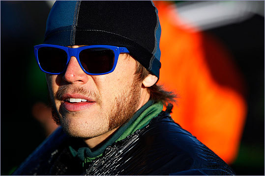 Thomas Walsh of Salt Lake City sports some cool shades as he waits for the race to start at Hopkinton High School.