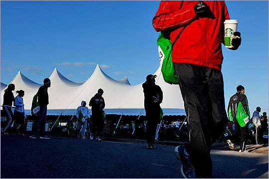 Runners are bundled up as they arrive at the Athletes' village at Hopkinton High School.