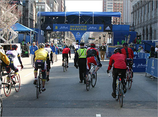 Bicyclists rode down Boylston Street and crossed the finish line before the start of the race.