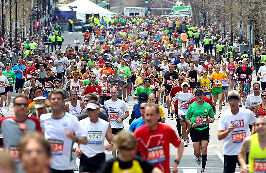 Throngs of runners had the finish line in sight as they ran the final yards of the marathon on Boylston Street.