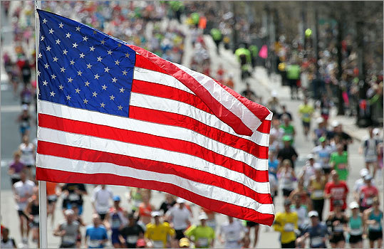 In a fitting sign of Patriots Day, an American flag flapped in the wind as runners neared the end of the marathon.