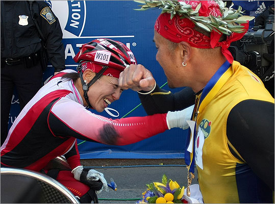 The winners of the wheelchair divisions, both from Japan, mens winner Masazumi Soejima (right) and womens champion Wakako Tsuchida greeted each other at the finish.