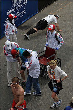As one runner was helped by a medical team, another did push-ups to cool down after the race.