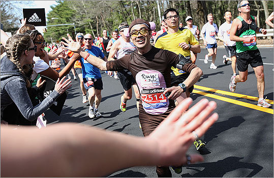 Runners smiled as they passed by throngs of cheering Wellesley students.