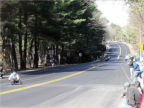 Wheelchair racers made their way down a hill in Wellesley.