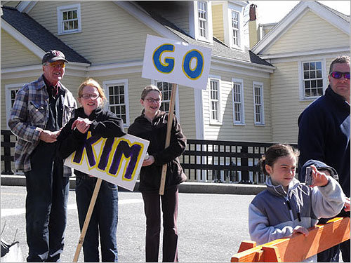 Spectators cheered on the marathoners as they touted signs.