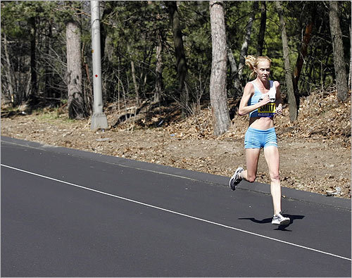 Kim Smith, of New Zealand, led the elite women during the running of the 115th Boston Marathon in Wellesley, Mass.