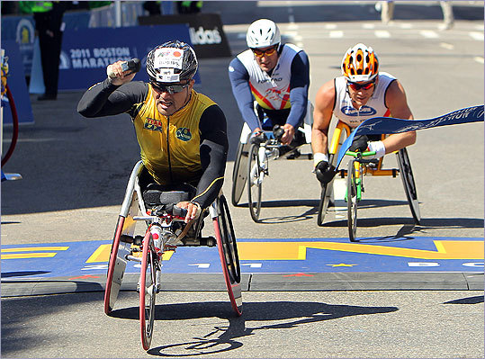 Masazumi Soejima celebrates his victory in the 115th Boston Marathon. Soejima finished in 1:18:50, just ahead of Kurt Fearnley and Ernst Van Dyk.