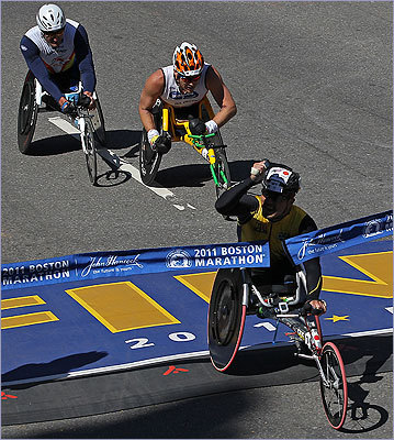 Japan's Masazumi Soejima is pumped as he break the tape to earn a win at the 115th Boston Marathon.