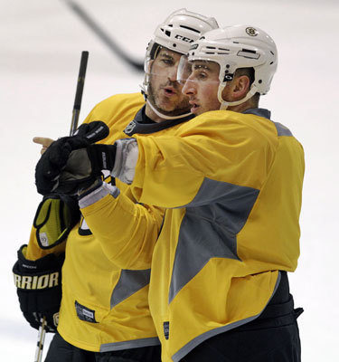 Veteran Mark Recchi (left) had a word on the ice with rookie Brad Marchand (right) during Wednesday's practice.