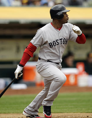 April 20: Red Sox 5. Athletics 3 Red Sox left fielder Carl Crawford follows through on an RBI single hit off Oakland Athletics' Gio Gonzalez during the second inning Wednesday.