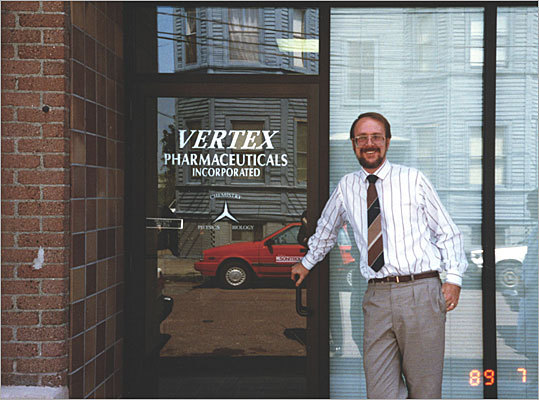 Joshua Boger founded Vertex Pharmaceuticals in 1989 in Cambridgeport – you can see Boger at the first office in the picture to the left. At first, the biotechnology start-up was easy-going, small, and at the forefront of the biotech revolution. It used advanced computer programs under a structure-based drug design approach to identify compounds that could be used to create new drugs.