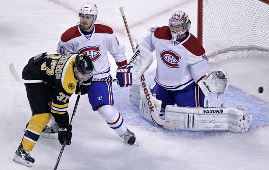 Game 7: Bruins 4, Canadiens 3 Johnny Boychuk (not pictured) gave the Bruins a 1-0 lead in Game 7 with a slap shot that beat Price three minutes, 31 seconds into the game. Patrice Bergeron (left) and James Wisnewski awaited a rebound that never came in front of the net.