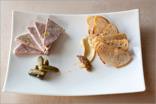 The house-made pork pate at Lily Bistro. Served with crostini, whole grain mustard, and cornichons. Read: Small food, big chefs