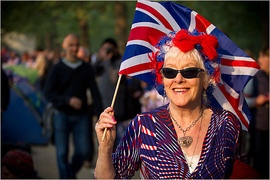 Pictured, Frances Stewart, 78, of Peckham, England, smiled her way down the Mall to Buckingham Palace.