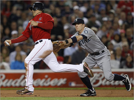 April 29: Mariners 5, Red Sox 4 Catcher Jason Varitek (left) was tagged out by Mariners shortstop Brendan Ryan on a double play ball hit by Dustin Pedroia in the fourth inning.