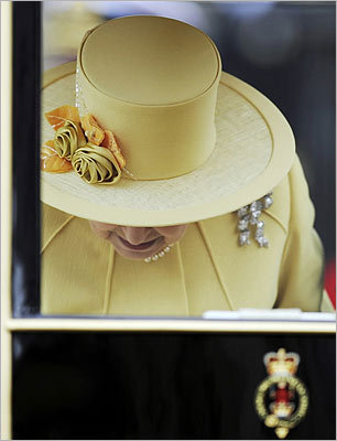 Queen Elizabeth inside a carriage after the royal wedding.