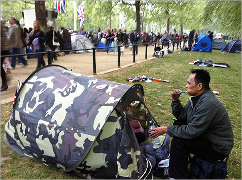 Anthony Arandia, of Kent, England, brushed his teeth after a night of camping near Buckingham Palace.