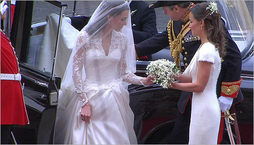Kate Middleton (left) received flowers from her sister, Pippa Middleton, as she arrived at Westminster Abbey.