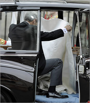 Kate Middleton's father, Michael Middleton, picked up her train from the back of their car at Westminster Abbey.