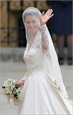 Kate Middleton waved to the crowd as her sister and maid of honor, Pippa Middleton, held her dress before walking into Westminster Abbey.