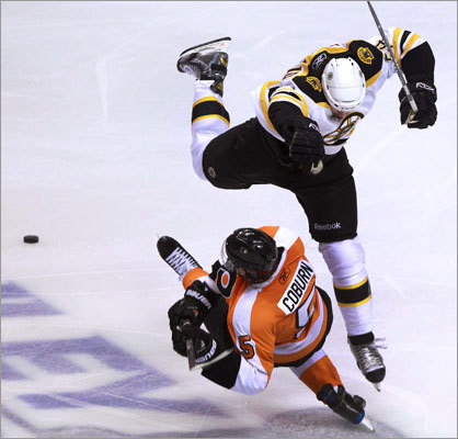 Bruins defenseman Adam McQuaid (top) and Flyers defenseman Braydon Coburn collided at center ice in the second period.