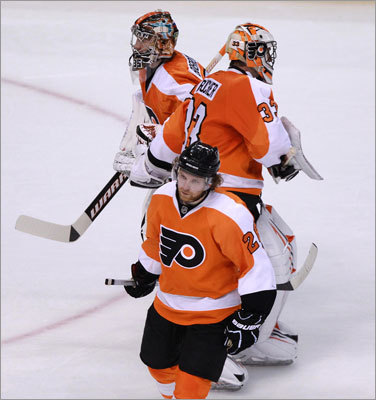 The Flyers didn't get the same quality goaltending that the Bruins did, and starter Brian Boucher (right) was replaced by Sergei Bobrovsky in the second period. Boucher allowed five goals.