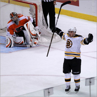 Center Brad Marchand (right) scored two goals to lead the Bruins to a 7-3 victory over the Flyers Saturday in Game 1 of their conference semifinal playoff series in Philadelphia. Marchand scored in the second and third period and the Bruins took a 1-0 series lead.