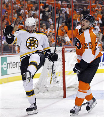 Krejci (left) scored 1 minute, 52 seconds into the game to put the Bruins up 1-0. The Flyers' Matt Carle is at right.