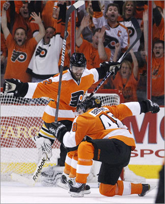 Danny Briere (right) scored 11 minutes into the first period to tie the score at 1-1, then celebrated with Ville Leino.